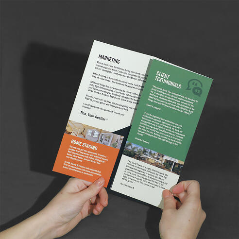 Tri-fold brochure with hands displaying the folding.